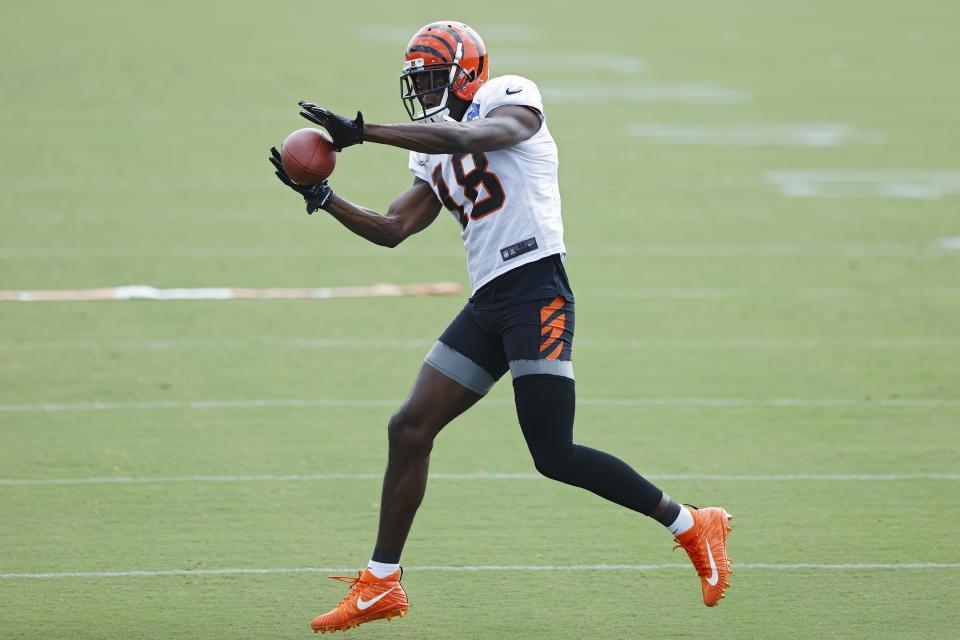 A.J. Green #18 of the Cincinnati Bengals catches a pass during training camp workouts