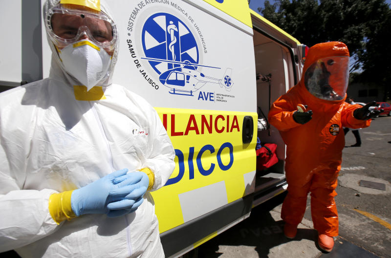A doctor and a paramedic from the Emergency Medical Care System (SAMU) of Jalisco stand inside the mobile intensive care medical unit the UTIM, the first in Latin America equipped to transfer people infected with the COVID-19 virus in Guadalajara, Jalisco state, Mexico on March 2, 2020. (Photo by Ulises Ruiz / AFP) (Photo by ULISES RUIZ/AFP via Getty Images)