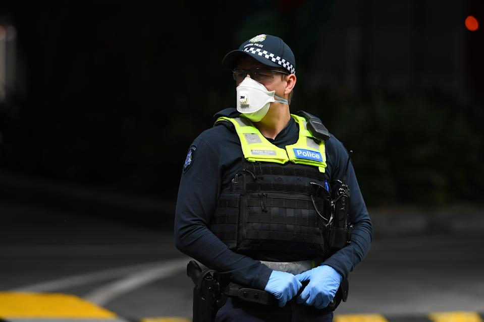 A police officer with a face mask on. Officers will be out in force over the Easter long weekend to make sure people follow self-isolation and social-distancing rules.