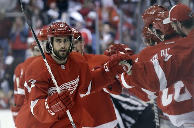 Detroit Red Wings right wing Patrick Eaves (17) celebrates scoring a goal against the Chicago Blackhawks during the first period in Game 6 of the Western Conference semifinals in the NHL hockey Stanley Cup playoffs in Detroit, Monday, May 27, 2013. (AP Photo/Paul Sancya)