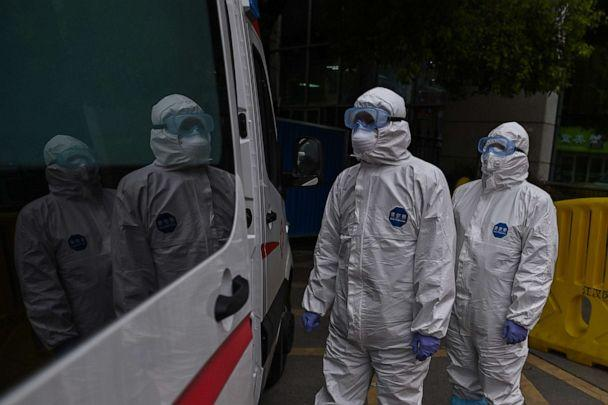PHOTO: Ambulance medical staff arrive at Wuhan Red Cross Hospital with an elderly woman, who recovered from COVID-19, at Wuhan in China's central Hubei province, March 30, 2020. (AFP via Getty Images, FILE)