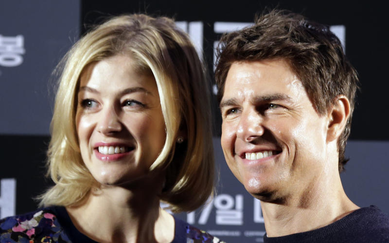 """U.S. actor Tom Cruise and British actress Rosamund Pike pose for photographers during a news conference to promote their film """"Jack Reacher"""" in Seoul, South Korea, Thursday, Jan. 10, 2013. Even though he turned 50 last summer and has been a Hollywood star for three decades, Tom Cruise says he still has fun making movies. (AP Photo/Lee Jin-man)"""
