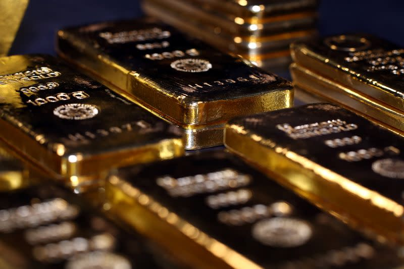 Gold slips as signing of trade deal and U.S. data prop up stock markets