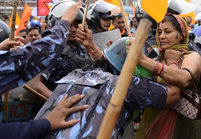 Nepalese police clash with Hindu activists as they try to break through a cordoned-off area near parliament in Kathmandu on September 14, 2015 (AFP Photo/Prakash Mathema)