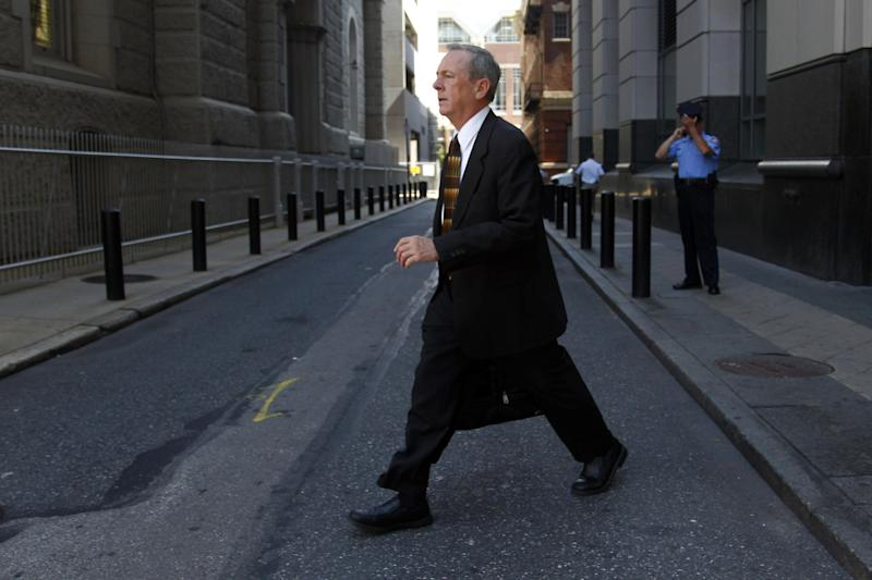 The Rev. James J. Brennan walks from the Criminal Justice Center, Thursday, June 14, 2012, in Philadelphia. Brennan is charged with the attempted rape of a 14-year-old boy in the 1990s. Brennan is on trial with Monsignor William Lynn, the former secretary for clergy in the Philadelphia archdiocese. Lynn is the first U.S. church official charged over his handling of sex-abuse complaints. (AP Photo/Matt Rourke)