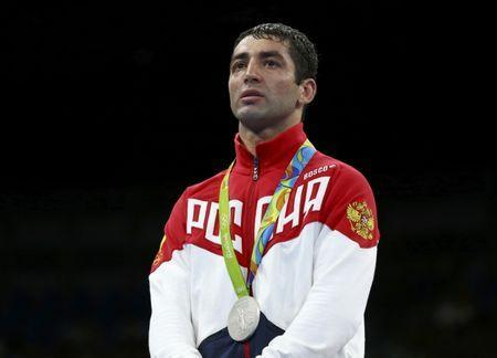 2016 Rio Olympics - Boxing - Victory Ceremony - Men's Fly (52kg) Victory Ceremony - Riocentro - Pavilion 6 - Rio de Janeiro, Brazil - 21/08/2016. Silver medallist Misha Aloian (RUS) of Russia reacts. REUTERS/Peter Cziborra