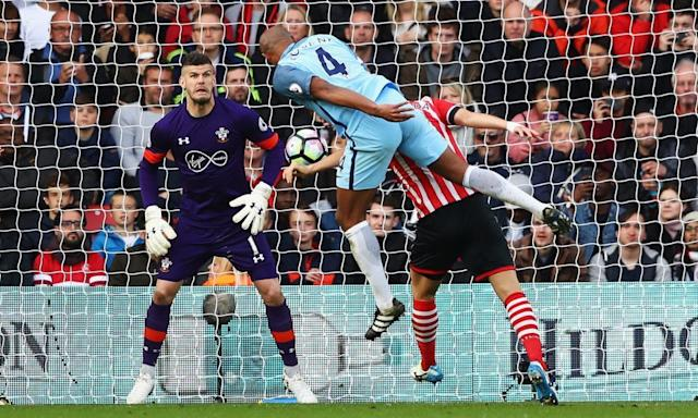 "<span class=""element-image__caption"">Vincent Kompany heads Manchester City's first goal that set them on their way to a 3-0 victory away to Southampton at St Mary's.</span> <span class=""element-image__credit"">Photograph: Michael Steele/Getty Images</span>"