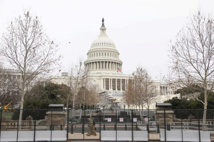 FILE PHOTO: Members of the National Guard walk in front of the U.S. Capitol in Washington