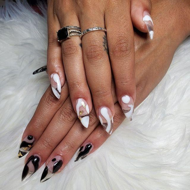 """<p>You might need a particular <a href=""""https://www.cosmopolitan.com/style-beauty/beauty/a30172434/manicure-types-guide/"""" rel=""""nofollow noopener"""" target=""""_blank"""" data-ylk=""""slk:type of manicure"""" class=""""link rapid-noclick-resp"""">type of manicure</a> with nail extensions to get these cool see-through tips, but the organic lines and <strong>abstract patterns you can totally do yourself</strong>.</p><p><a href=""""https://www.instagram.com/p/B485216nOzb/?utm_source=ig_embed&utm_campaign=loading"""" rel=""""nofollow noopener"""" target=""""_blank"""" data-ylk=""""slk:See the original post on Instagram"""" class=""""link rapid-noclick-resp"""">See the original post on Instagram</a></p>"""