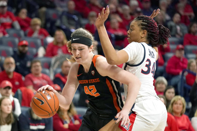 Oregon State forward Kennedy Brown, left, drives against Arizona center Semaj Smith (34) during the first half of an NCAA college basketball game Friday, Jan. 10, 2020, in Tucson, Ariz. (AP Photo/Rick Scuteri)