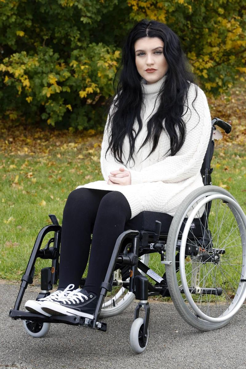 However she was crushed by a 70kg weight and broke her spine. Photo: Caters News