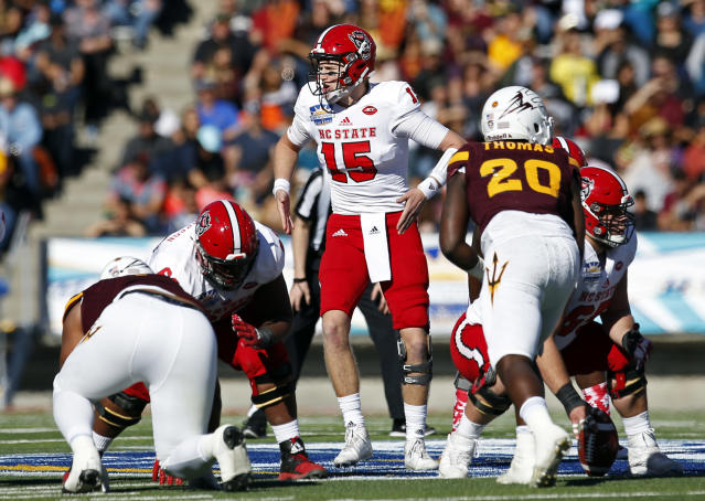 "North Carolina State quarterback <a class=""link rapid-noclick-resp"" href=""/ncaaf/players/225942/"" data-ylk=""slk:Ryan Finley"">Ryan Finley</a> (15) signals instructions to his teammates during the fist half of the Sun Bowl NCAA college football game against Arizona State in El Paso, Texas, Friday, Dec. 29, 2017. (AP Photo/Andres Leighton)"