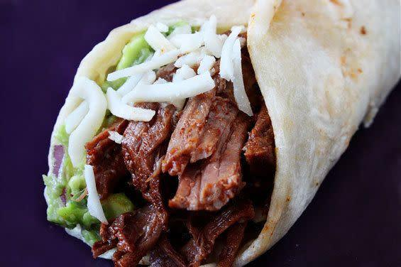 "<strong>Get the recipe for <a href=""http://www.gimmesomeoven.com/slow-cooker-shredded-beef-tacos/"" rel=""nofollow noopener"" target=""_blank"" data-ylk=""slk:slow cooker shredded beef tacos"" class=""link rapid-noclick-resp"">slow cooker shredded beef tacos</a> by Gimme Some Oven.</strong>"