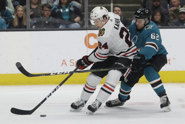 Chicago Blackhawks center Dominik Kahun (24) skates with the puck in front of San Jose Sharks right wing Kevin Labanc (62) during the first period of an NHL hockey game in San Jose, Calif., Sunday, March 3, 2019. (AP Photo/Jeff Chiu)