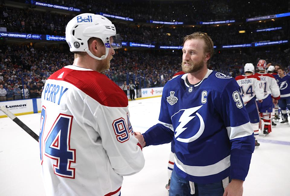 TAMPA, FLORIDA - JULY 07: Corey Perry #94 of the Montreal Canadiens and Steven Stamkos #91 of the Tampa Bay Lightning shake hands after the Tampa Bay Lightning 1-0 victory in Game Five of the 2021 Stanley Cup Final to win the series four games to one against the Montreal Canadiens at Amalie Arena on July 07, 2021 in Tampa, Florida. (Photo by Dave Sandford/NHLI via Getty Images)