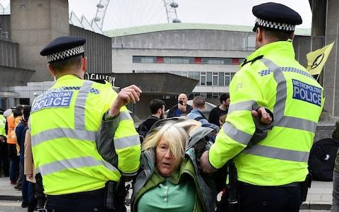 Activists have been forcibly removed from Waterloo Bridge - Credit: DANIEL LEAL-OLIVAS/AFP