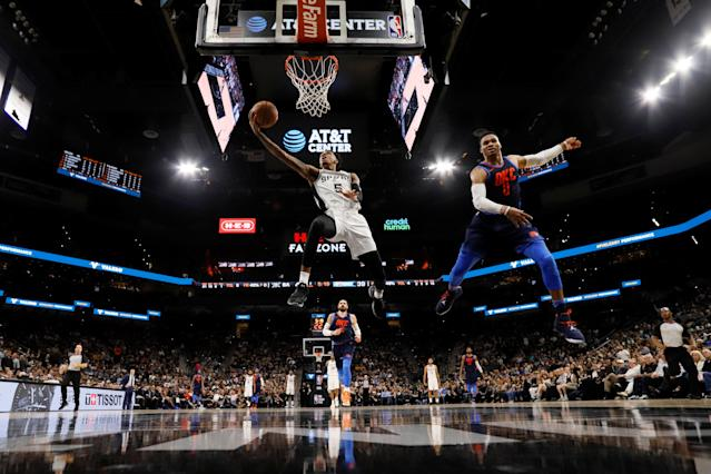 Mar 29, 2018; San Antonio, TX, USA; San Antonio Spurs point guard Dejounte Murray (5) shoots the ball past Oklahoma City Thunder point guard Russell Westbrook (0) during the first half at AT&T Center. Mandatory Credit: Soobum Im-USA TODAY Sports TPX IMAGES OF THE DAY