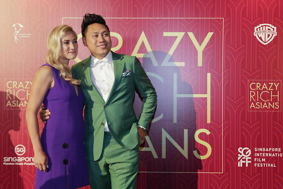 <p>Director Jon M. Chu and wife Kristin Hodge pose for photographers at the Singapore premiere of 'Crazy Rich Asians' on 21 August 2018. (PHOTO: Yahoo Lifestyle Singapore) </p>