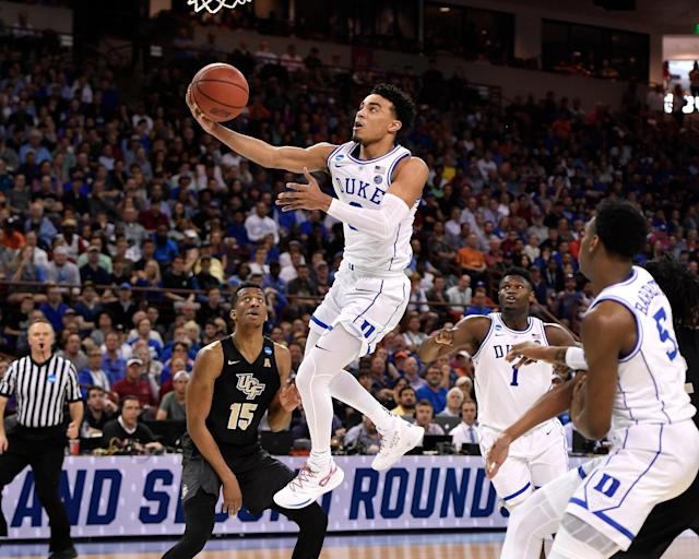 <p>Tre Jones #3 of the Duke Blue Devils goes to the basket against the Central Florida Knights in the first half during the second round of the 2019 NCAA Men's Basketball Tournament at Colonial Life Arena on March 24, 2019 in Columbia, South Carolina. (Photo by Lance King/Getty Images) </p>