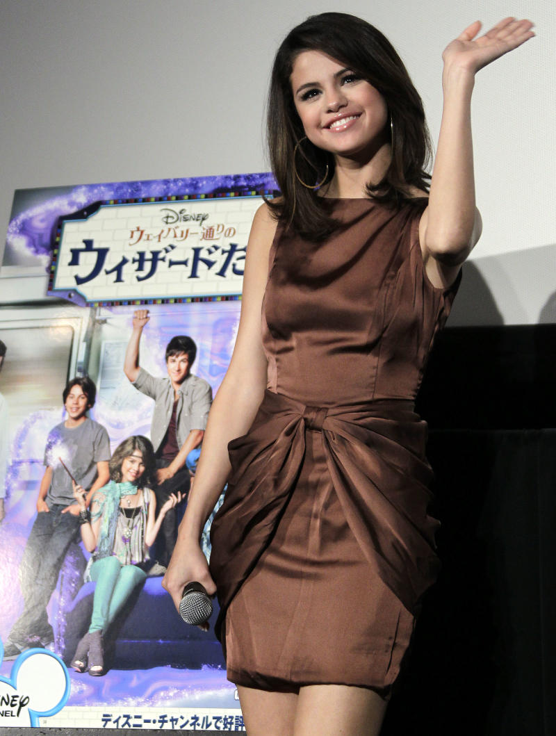 """Disney teen star Selena Gomez waves during a fan meeting in Tokyo following a special preview of the first episode of the latest TV series """"Wizards of Waverly Place"""" Monday, Feb. 21, 2011. (AP Photo/Koji Sasahara)"""