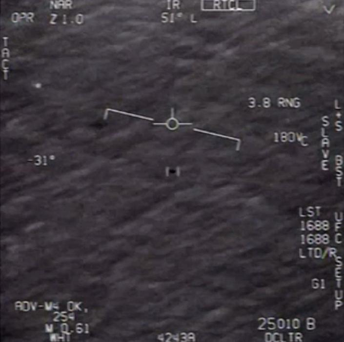 """This file video grab image by US Department of Defense shows part of an unclassified video taken by Navy pilots that have circulated for years showing interactions with """"unidentified aerial phenomena"""". (DoD/AFP via Getty Images)"""