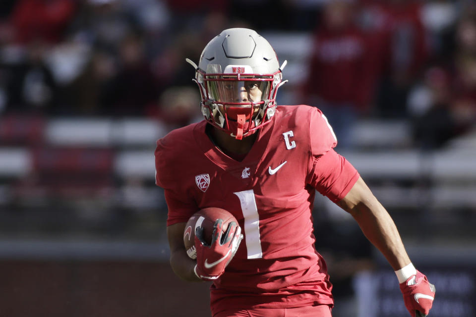 Washington State wide receiver Travell Harris carries the ball during the second half of an NCAA college football game against Oregon State, Saturday, Oct. 9, 2021, in Pullman, Wash. Washington State won 31-24. (AP Photo/Young Kwak)