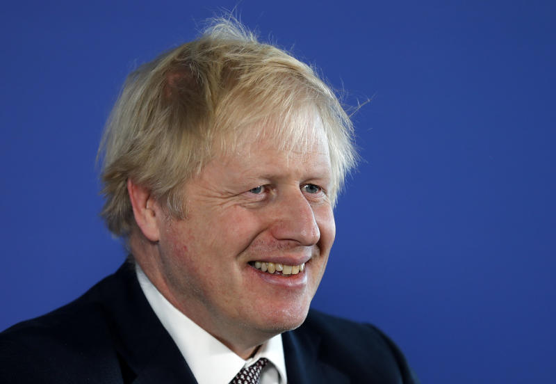 Britain's Prime Minister Boris Johnson smiles during a media conference in London, Friday, Nov. 29, 2019. Britain goes to the polls on Dec. 12. (AP Photo/Frank Augstein)