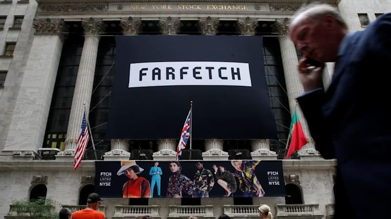 A banner to celebrate the IPO of online fashion house Farfetch is displayed on the facade of the of the New York Stock Exchange (NYSE) in New York, U.S., September 21, 2018.