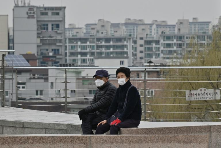 People wearing face masks take a rest at a park in Daegu, epicentre of the South Korean outbreak