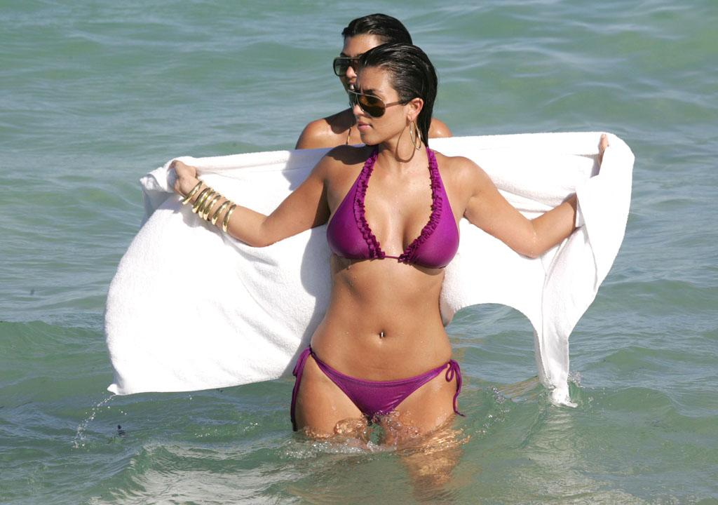 July 14, 2007: Kim Kardashian takes a dip in the ocean in South Beach Miami, Florida. 