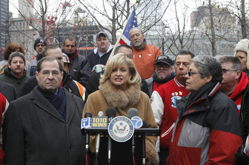 Rep. Carolyn Maloney, center, D-N.Y., is joined by Rep. Jerry Nadler, left, D-N.Y.,  and by 9/11 responders and survivors and union leaders during a news conference near ground zero, Friday, Dec. 10, 2010 in New York.  Maloney and Nadler, the authors of H.R. 847, the James Zadroga 9/11 Health and Compensation Act, held the news conference to demand that Senate Republicans stop obstructing the passage of the Zadroga Act.  (AP Photo/Mary Altaffer)
