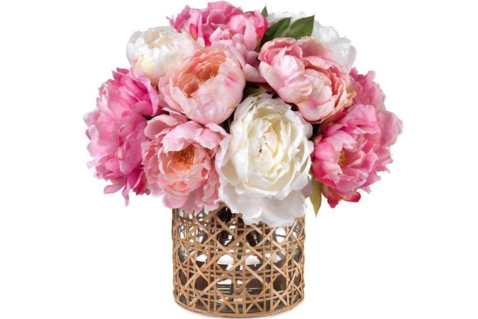 "<p>graymalin.com</p><p><strong>$625.00</strong></p><p><a href=""https://www.graymalin.com/products/oversized-mixed-peonies-cane-vase"" rel=""nofollow noopener"" target=""_blank"" data-ylk=""slk:Shop Now"" class=""link rapid-noclick-resp"">Shop Now</a></p><p>Give them one less thing to worry about after moving into a new home with a vibrant bouquet of faux florals from Gray Malin's new collaboration with Diane James. Adorned in a cane vase, these blooms are sure to put a smile on their face for years to come.</p>"