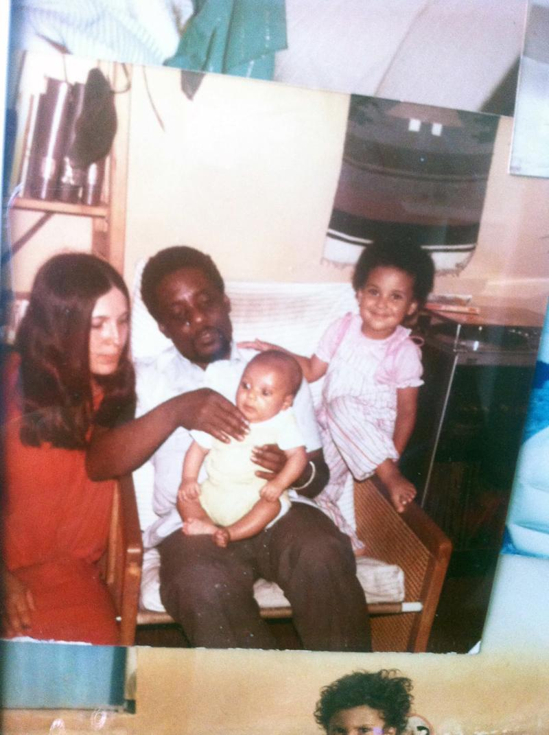 My mother, father, and me with my baby brother Chike.