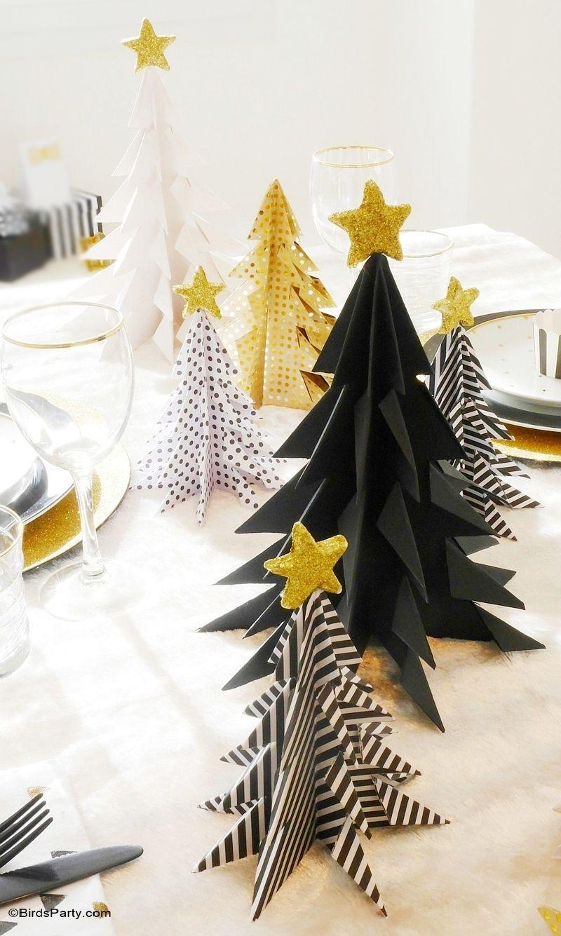 "<p>The chicest origami has ever looked. Choose black, gold, and white paper for a display that can last through New Year's.</p><p>Get the tutorial at <a href=""https://www.blog.birdsparty.com/2015/12/diy-origami-christmas-trees-paper-tutorial-crafts-holidays.html"" rel=""nofollow noopener"" target=""_blank"" data-ylk=""slk:Bird's Party"" class=""link rapid-noclick-resp"">Bird's Party</a>.</p>"