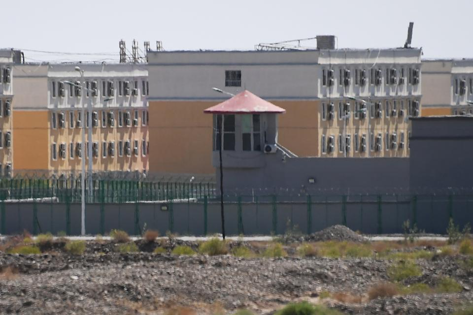 This photo taken on June 2, 2019 shows buildings at the Artux City Vocational Skills Education Training Service Center, believed to be a re-education camp where mostly Muslim ethnic minorities are detained, north of Kashgar in China's northwestern Xinjiang region. - As many as one million ethnic Uighurs and other mostly Muslim minorities are believed to be held in a network of internment camps in Xinjiang, but China has not given any figures and describes the facilities as Òvocational education centresÓ aimed at steering people away from extremism. (Photo by GREG BAKER / AFP) / TO GO WITH China-Xinjiang-media-rights-press,FOCUS by Eva XIAO        (Photo credit should read GREG BAKER/AFP via Getty Images)