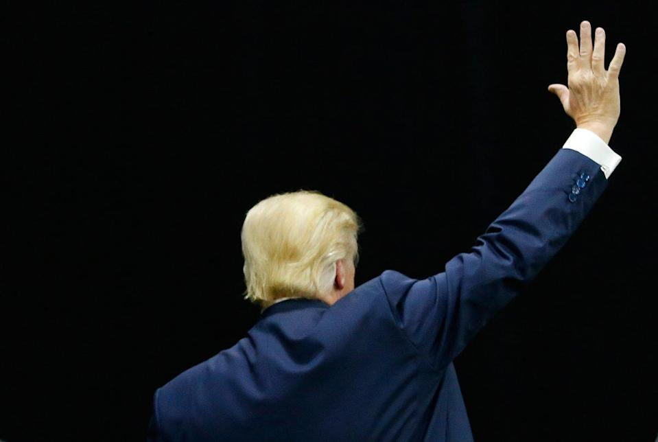 Donald Trump waves goodbye to the crowd at the end of a campaign event on Sept. 29, 2016. Photo from Getty Images