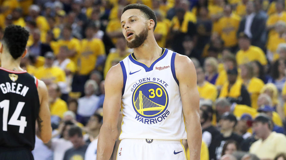 The Golden State Warriors Steph Curry looks disappointed.