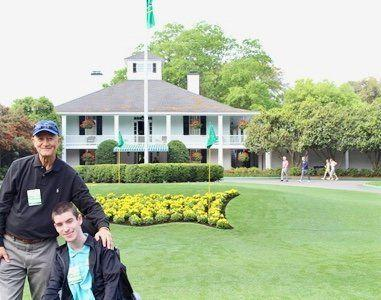 Taylor Parrott and his father Chip got a photo taken in front of the Augusta National clubhouse. (Courtesy of Parrott family)