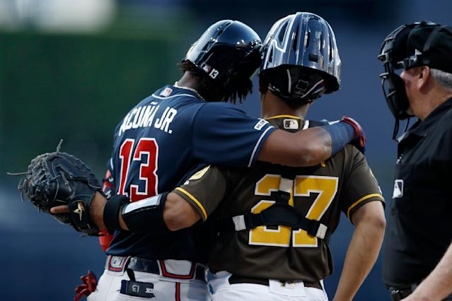 Atlanta Braves' Ronald Acuna Jr. (13) hugs San Diego Padres catcher Francisco Mejia (27) as he steps up to bat during the first inning of a baseball game Friday, July 12, 2019, in San Diego. (AP Photo/Gregory Bull)