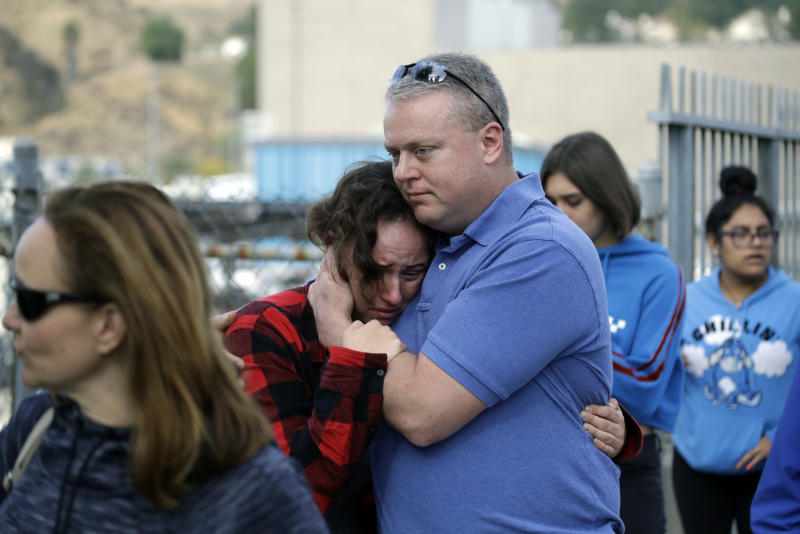 Students are escorted out of Saugus High School as some parents join them after reports of a shooting on Nov. 14, 2019, in Santa Clarita, Calif. (Photo: Marcio Jose Sanchez/AP)