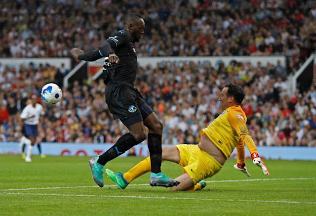Soccer Football - Soccer Aid 2018 - England v Soccer Aid World XI - Old Trafford, Manchester, Britain - June 10, 2018 World XI's Usain Bolt in action with England's David Seaman REUTERS/Phil Noble