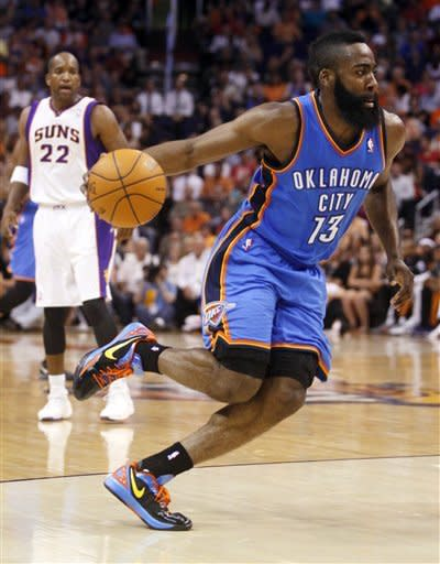 Oklahoma City Thunder guard James Harden (13) drives against the Phoenix Suns during the first half of an NBA basketball game, Wednesday, April 18, 2012, in Phoenix. (AP Photo/Matt York)