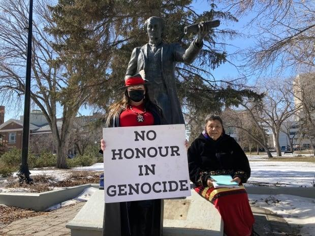 Star Andreas (left) and her mother Beatrice Laframboise held a protest at the Sir John A. Macdonald statue in Regina's Victoria Park on March 31 as council debated the removal of the statue.