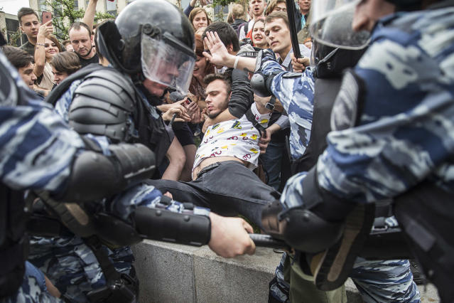 <p>Police detain a protester In Moscow, Russia, Monday, June 12, 2017. (Evgeny Feldman/AP) </p>