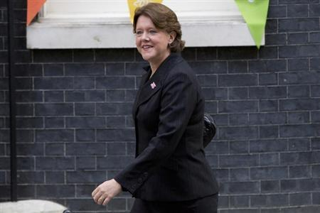 Newly assigned Culture Secretary Maria Miller leaves Downing Street in London