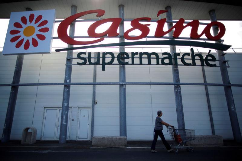 FILE PHOTO: A logo of French retailer Casino is pictured outside a Casino supermarket in Nantes, France, July 20, 2017. REUTERS/Stephane Mahe