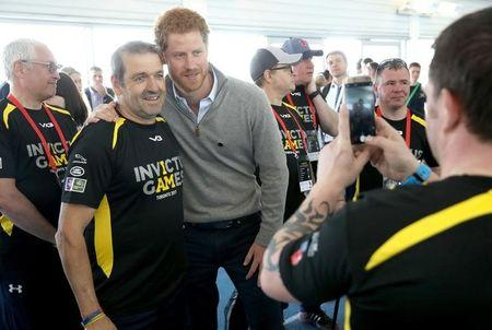 Britain's Prince Harry Patron of the Invictus Games Foundation, poses with a competitor as he attends the UK team trials for the Invictus Games Toronto 2017 held at the University of Bath