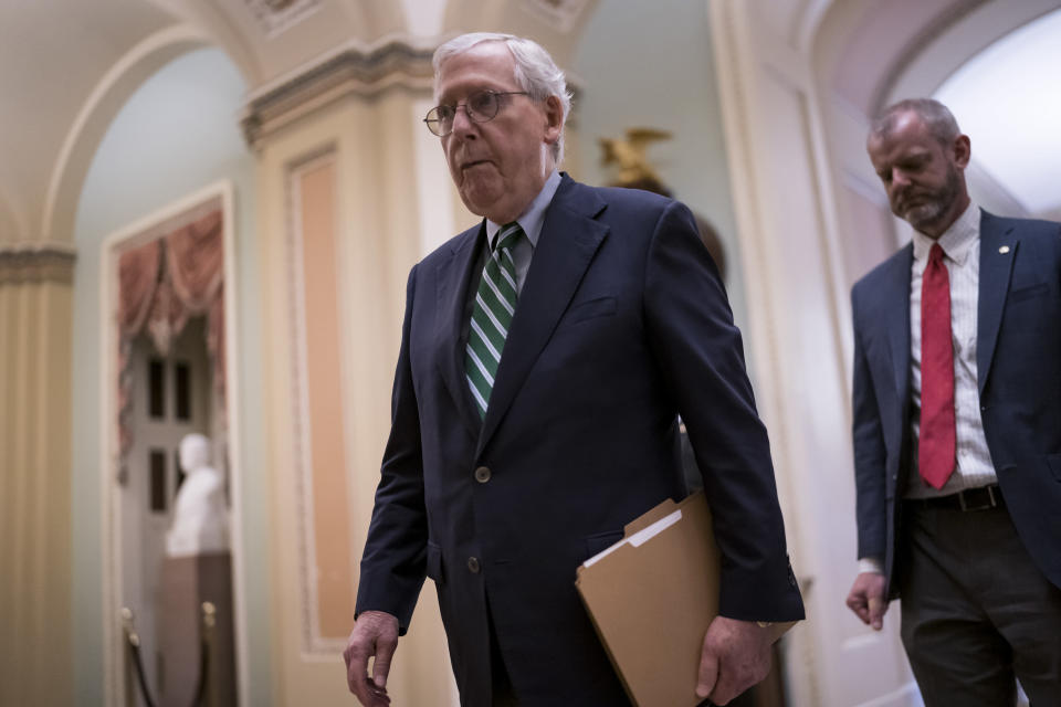 Senate Minority Leader Mitch McConnell, R-Ky., walks to the chamber to begin the work week at the Capitol in Washington, Monday, May 24, 2021. The House has already voted to approve an independent commission to investigate the Jan. 6 U.S. Capitol insurrection but the measure faces an uncertain fate in the evenly divided Senate where Republican leader Mitch McConnell is opposed and former President Donald Trump is demanding the effort be quashed. (AP Photo/J. Scott Applewhite)