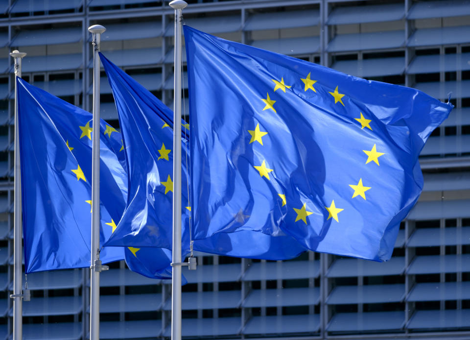 BRUSSELS, BELGIUM - MAY 19: The EU flags are seen in front of the Berlaymont, the EU Commission headquarter on May 19, 2020, in Brussels, Belgium. The authorship of the flag is due to a suggestion by the Belgian Paul Michel Gabriel Lévy, Director of Information and Press at the Council of Europe or, according to other sources, to Léon Marchal Secretary General since September 21, 1953 The actual drawing of the flag model is most probably attributable to Arsène Heitzb, mail service agent at the Council of Europe and painter, who had taken an interest in the question and had proposed from 1952 in 1955 many versions based on circles of stars on a blue background. (Photo by Thierry Monasse/Getty Images)
