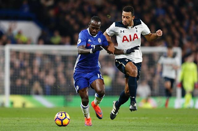 Chelsea's Victor Moses (L) scored his side's second goal in a 2-1 win over Tottenham Hotspur, to give Chelsea a seventh successive league win (AFP Photo/Ian Kington)